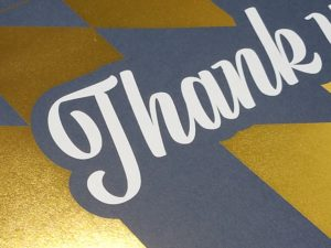 Digital Gold Foil with White Ink on Blue Stock - digital foil stamping